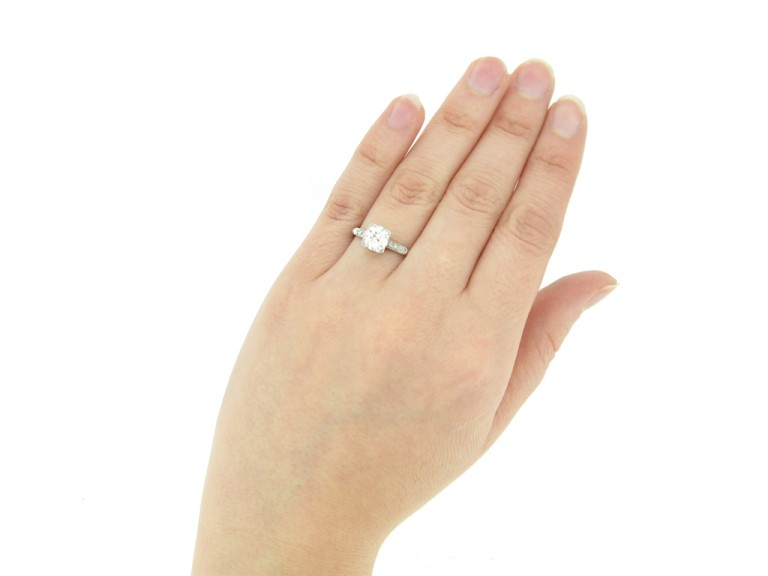 hand view Solitaire diamond ring with diamond set shoulders