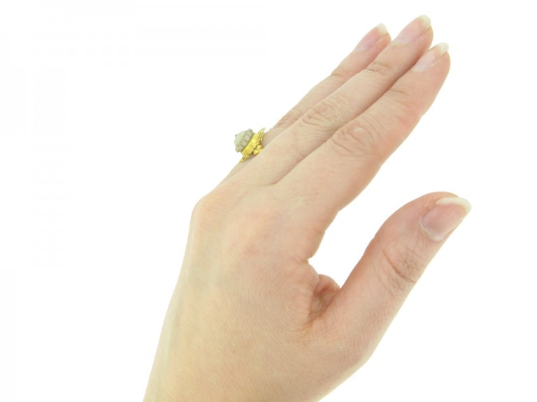 hand view Ancient Roman gold ring with cameo,