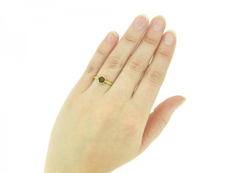 hand view Saxon gold ring set with garnet