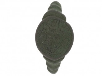 front view Medieval bronze ring with horned devil, circa 13th   15th century AD.