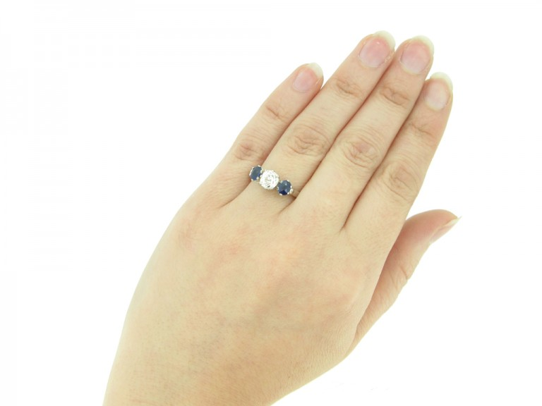 hand view Diamond and sapphire three stone ring