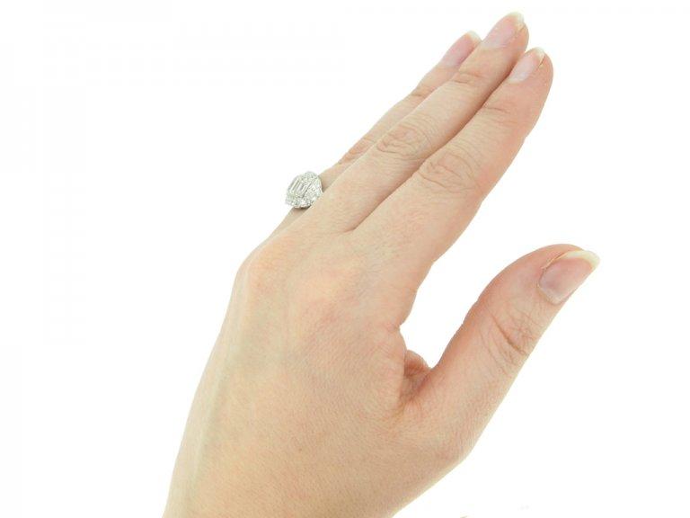 hand view Art Deco diamond cluster ring, American, circa 1935.