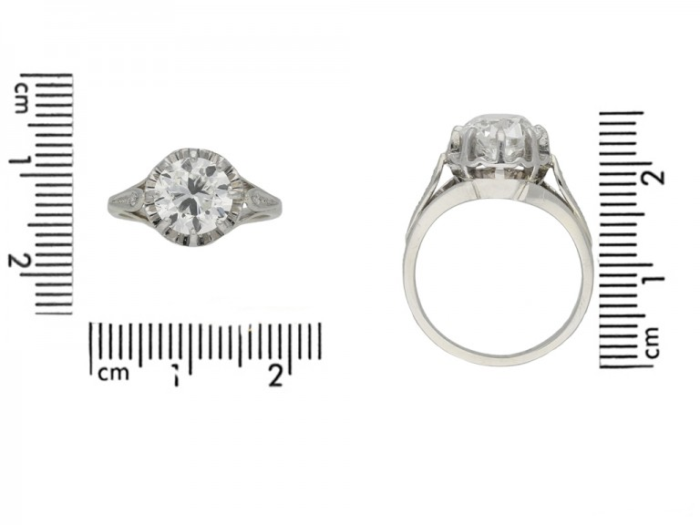 Solitaire diamond ring with diamond set shoulders, French, circa 1930.