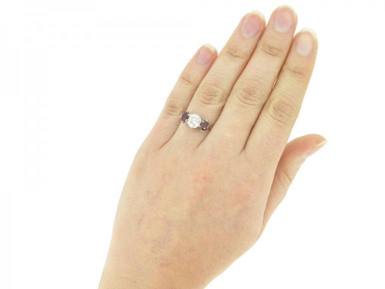 hand view Diamond and ruby three stone ring, circa 1920.