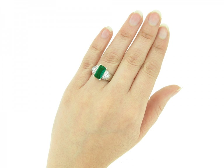 hand view Gubelin Colombian emerald and diamond ring, circa 1943.