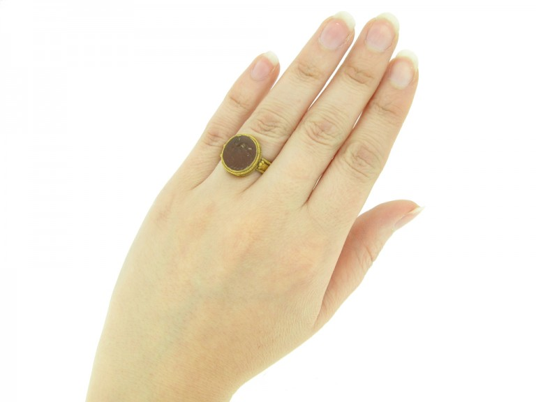 hand view Ancient Roman gold ring with intaglio of Neptune