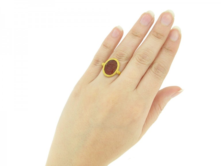 hand view Ancient Roman gold ring with intaglio of imperial eagle and standards
