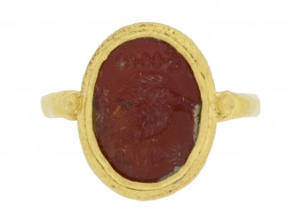 front view Ancient Roman gold ring with intaglio of imperial eagle and standards