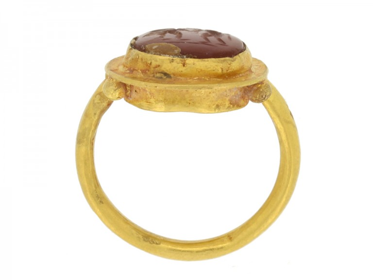 back view Ancient Roman gold ring with cornelian intaglio of wrestling putti