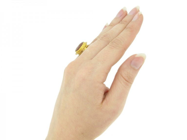hand view Ancient Roman gold ring with cornelian intaglio of wrestling putti