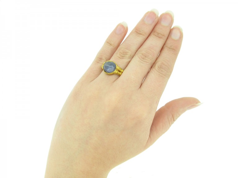 hand view Medieval zoomorphic sapphire ring, circa 12th   14th century.