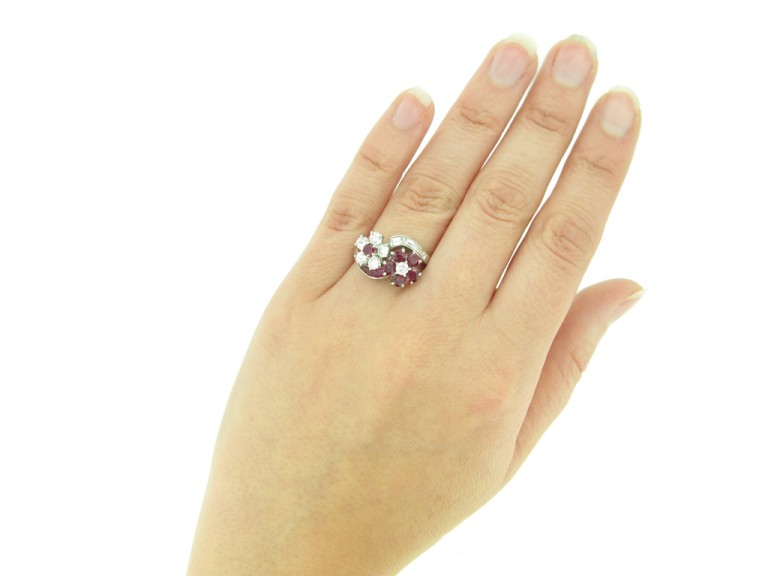 hand view Lambert Brothers ruby and diamond flower ring