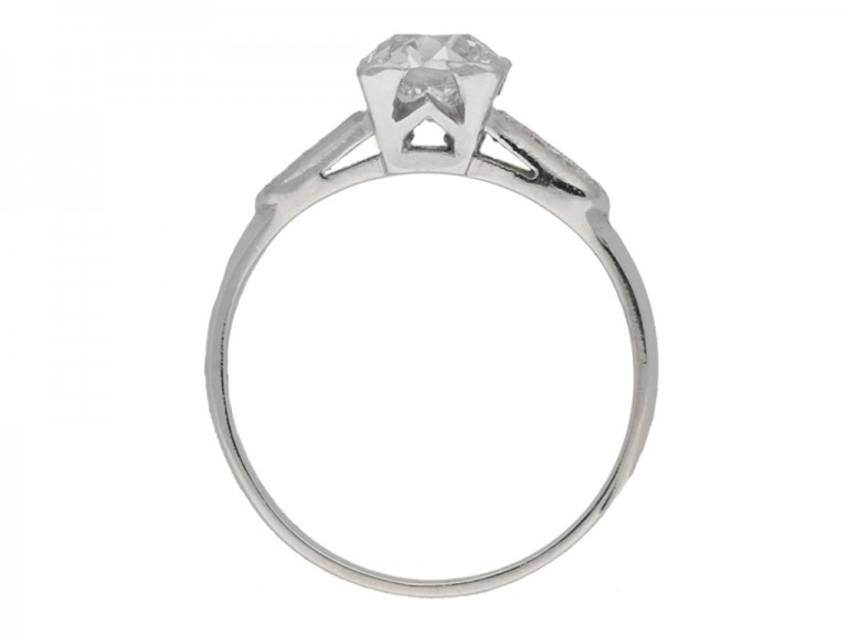 back view Solitaire diamond engagement ring with diamond set shoulders, circa 1930.