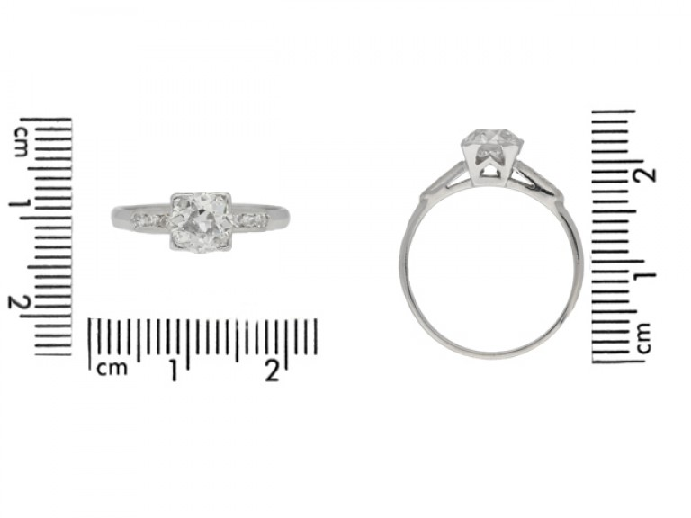 size view Solitaire diamond engagement ring with diamond set shoulders, circa 1930.