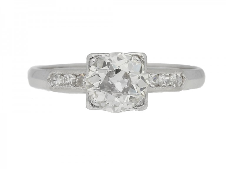 front view Solitaire diamond engagement ring with diamond set shoulders, circa 1930.