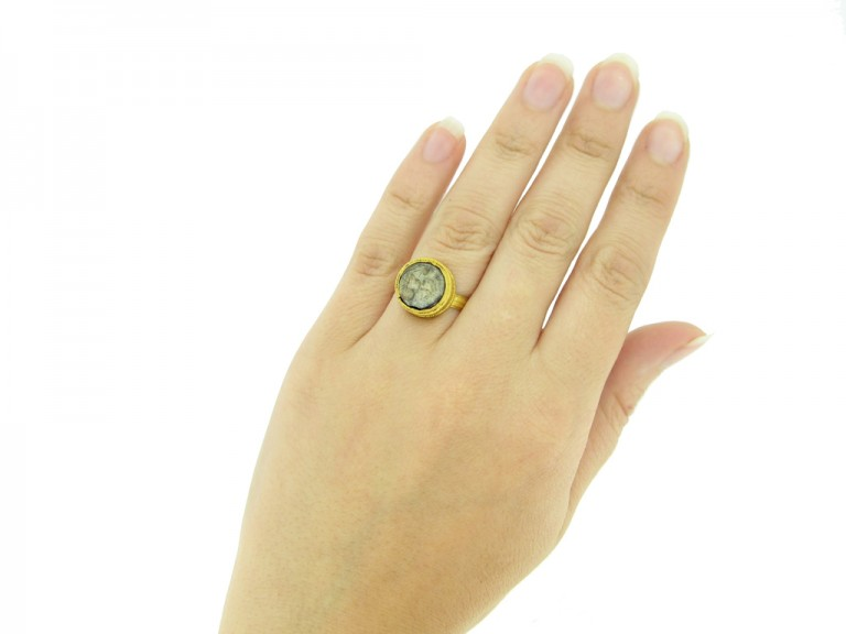 hand view Ancient Roman gold ring with intaglio circa 1st 2nd century AD.