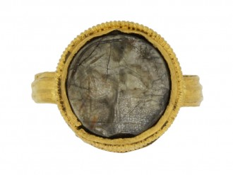 front view Ancient Roman gold ring with intaglio circa 1st 2nd century AD.