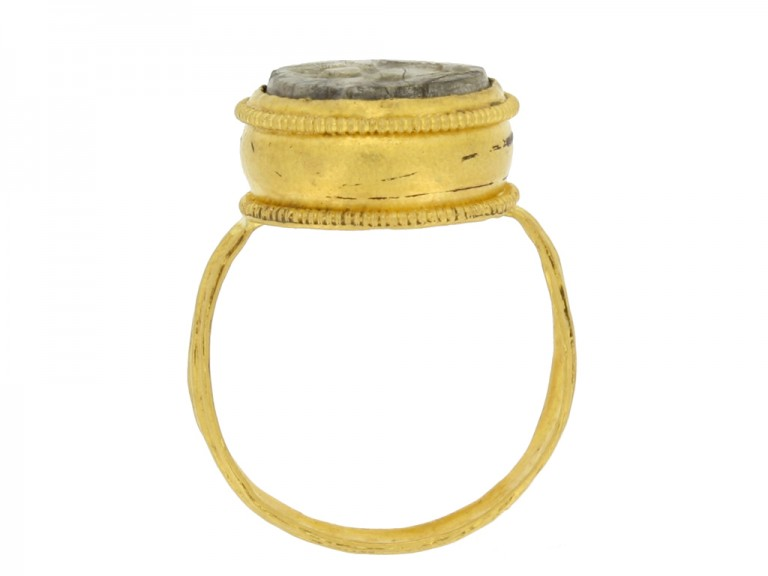 back view Ancient Roman gold ring with intaglio circa 1st 2nd century AD.