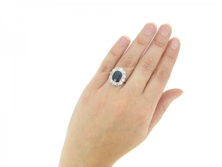 hand view Antique sapphire and diamond cluster engagement ring