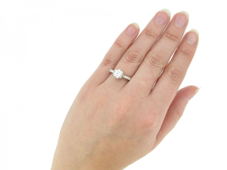 hand view Solitaire diamond engagement ring with diamond set shoulders