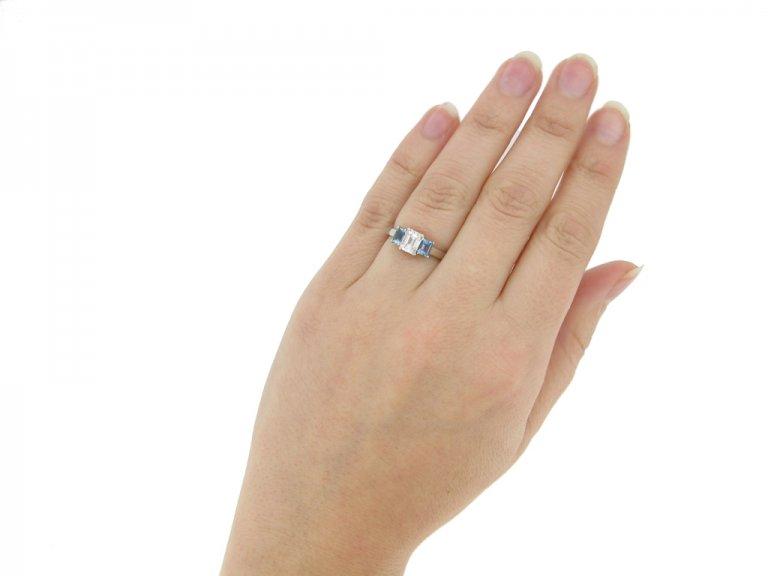 hand view Diamond and aquamarine three stone ring