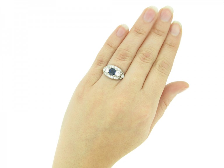 hand view Sapphire and diamond cluster engagement ring