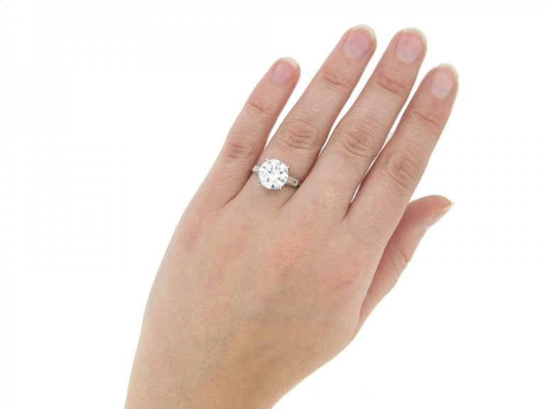 hand view Cartier solitaire diamond engagement ring