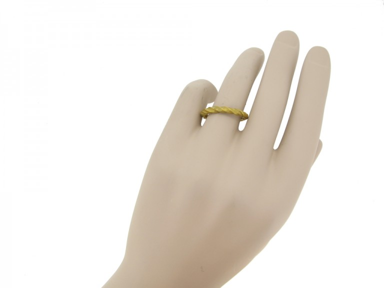 hand view Viking gold penannular twisted ring