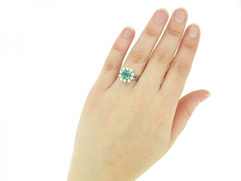 hand view Vintage Colombian emerald and diamond cluster ring, French, circa 1950s.