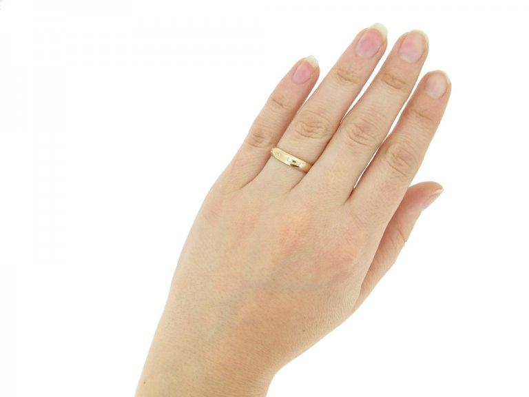 Diamond set wedding ring in rose gold, circa 1950.