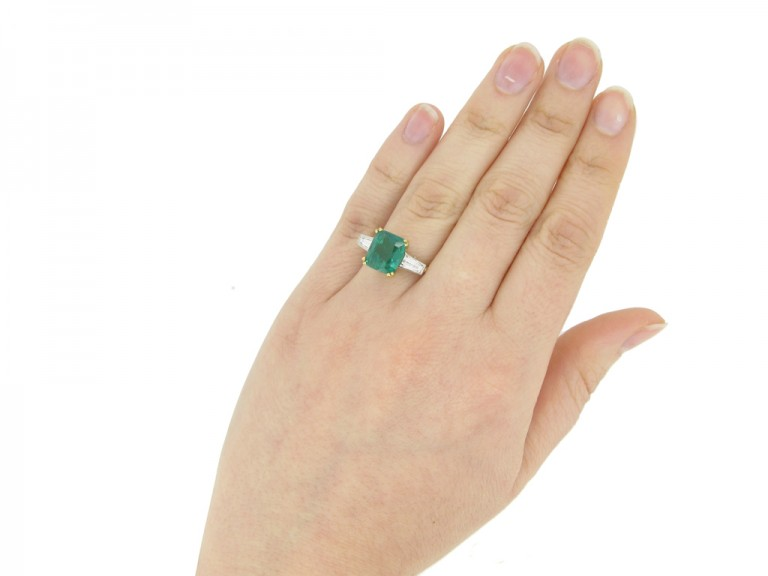 hand view Vintage emerald and diamond ring, circa 1950s.