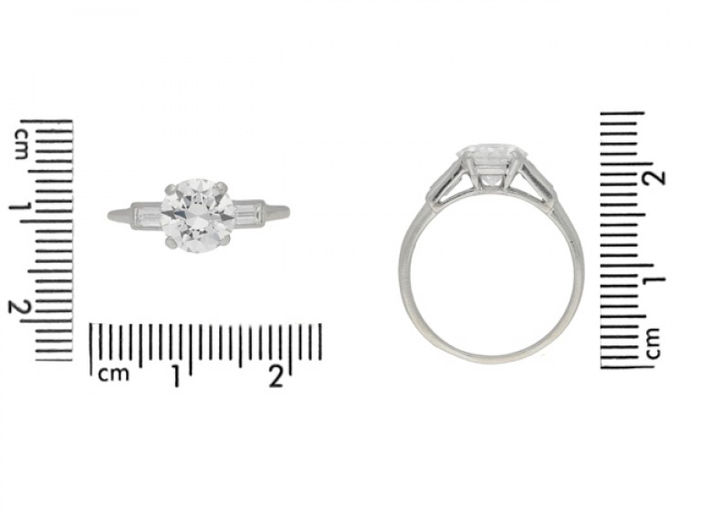 size view Solitaire diamond engagement ring with diamond set shoulders, circa 1925.