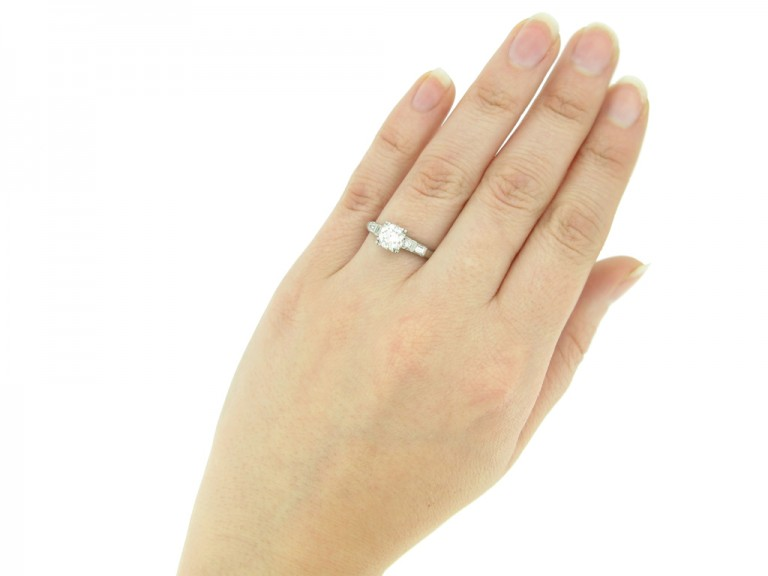 hand view Solitaire diamond ring with diamond set shoulders, American, circa 1950.