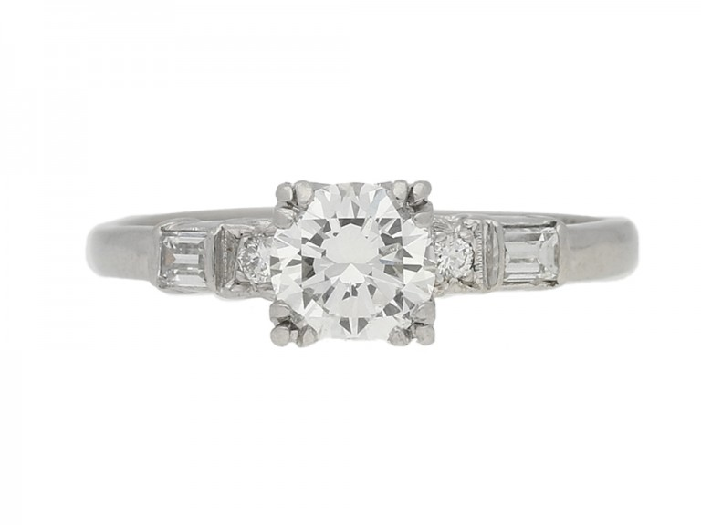 front view Solitaire diamond ring with diamond set shoulders, American, circa 1950.