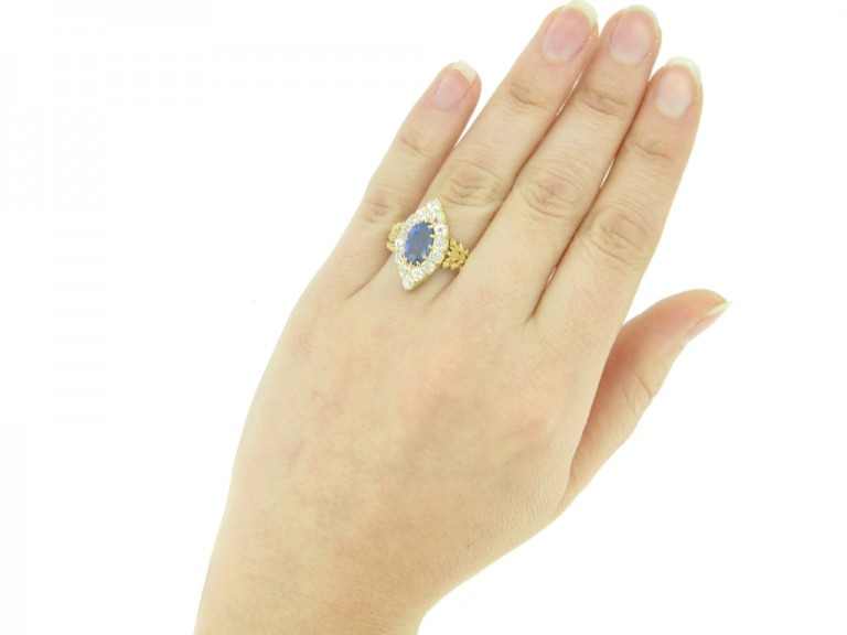 hand view Antique sapphire and diamond cluster ring, circa 1890.