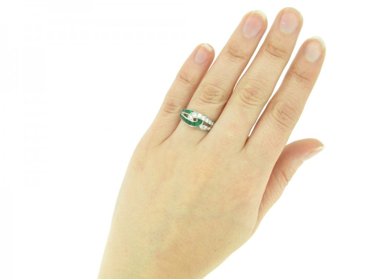 hand view Vintage emerald and diamond ring by Oscar Heyman Brothers, circa 1960s.