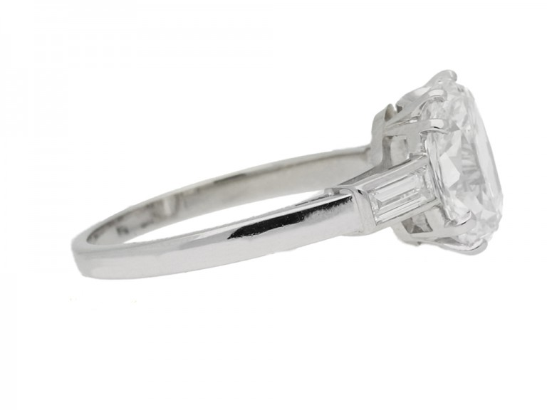 side view Cushion shape diamond ring with diamond set shoulders, circa 1950.