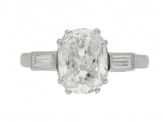 front view Cushion shape diamond ring with diamond set shoulders, circa 1950.