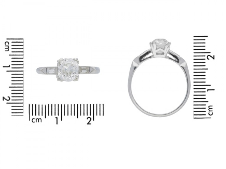 size view Solitaire diamond engagement ring with diamond set shoulders, American, circa 1925.