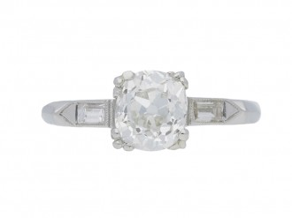 front view Solitaire diamond engagement ring with diamond set shoulders, American, circa 1925.