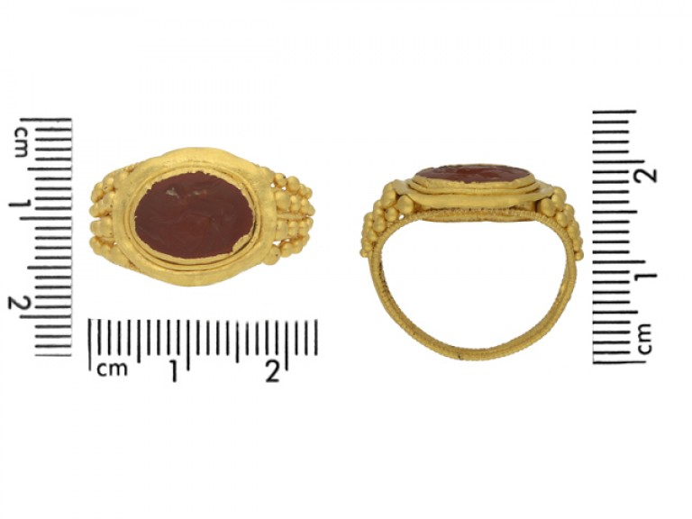 size view Ancient Roman gold ring with Cupid intaglio, circa 3rd century AD.