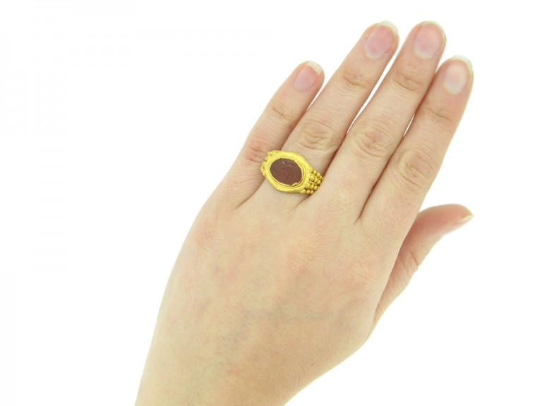front view Ancient Roman gold ring with Cupid intaglio, circa 3rd century AD.