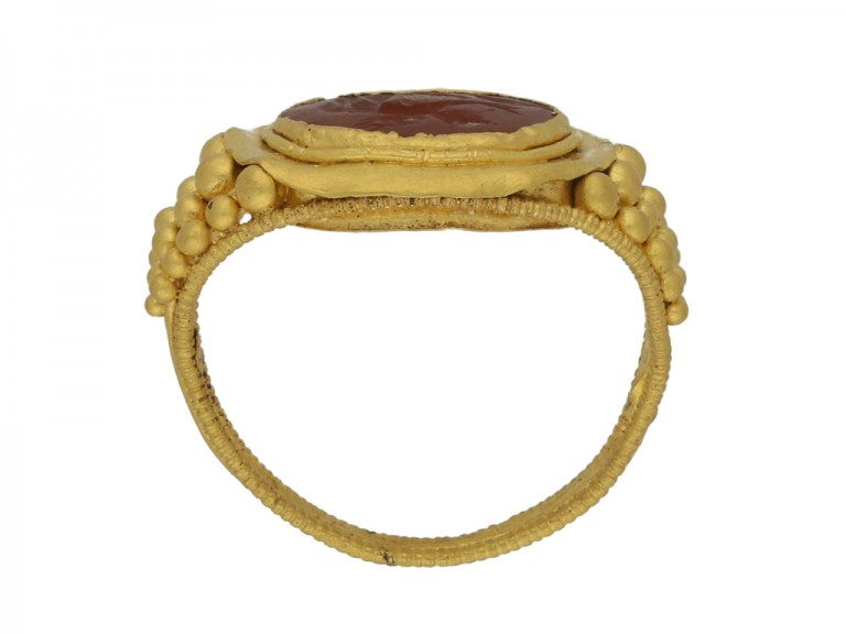 back view Ancient Roman gold ring with Cupid intaglio, circa 3rd century AD.