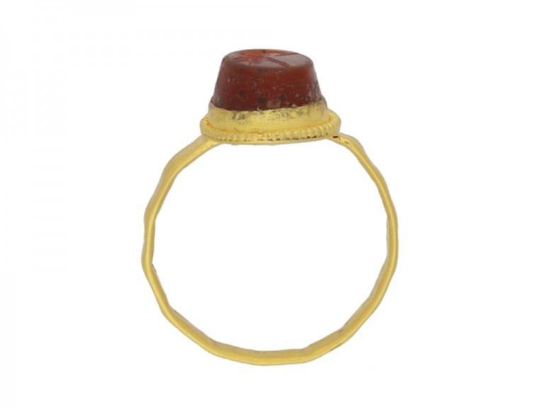 back view Ancient Roman gold ring with helmet intaglio, circa 3rd century AD.