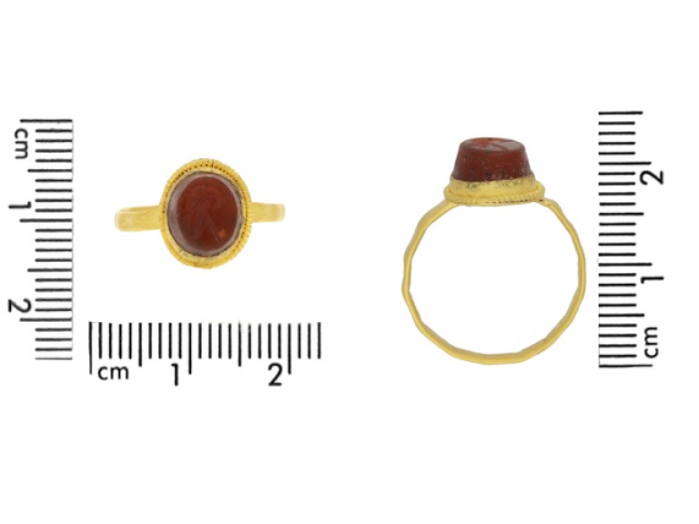 size view Ancient Roman gold ring with helmet intaglio, circa 3rd century AD.