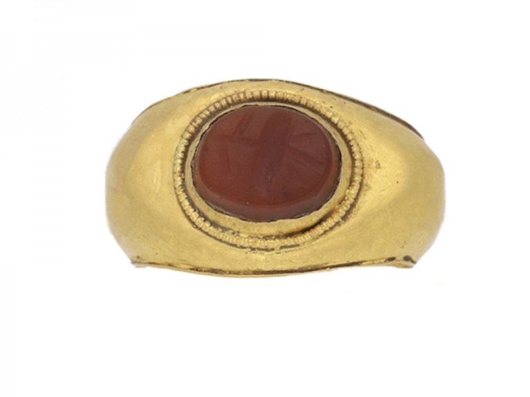 front view Ancient Roman gold ring with poppy intaglio, circa 1st   2nd century AD.