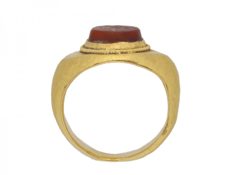 back view Ancient Roman gold ring with poppy intaglio, circa 1st   2nd century AD.