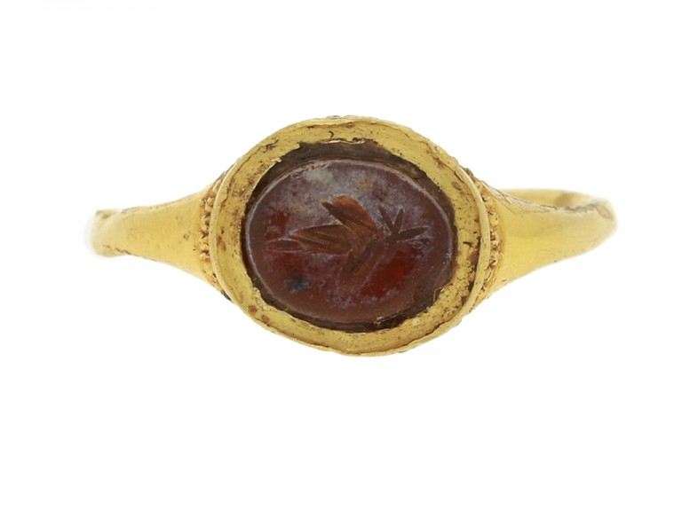 front view Ancient Roman gold ring with vine leaf intaglio, circa 3rd century AD.