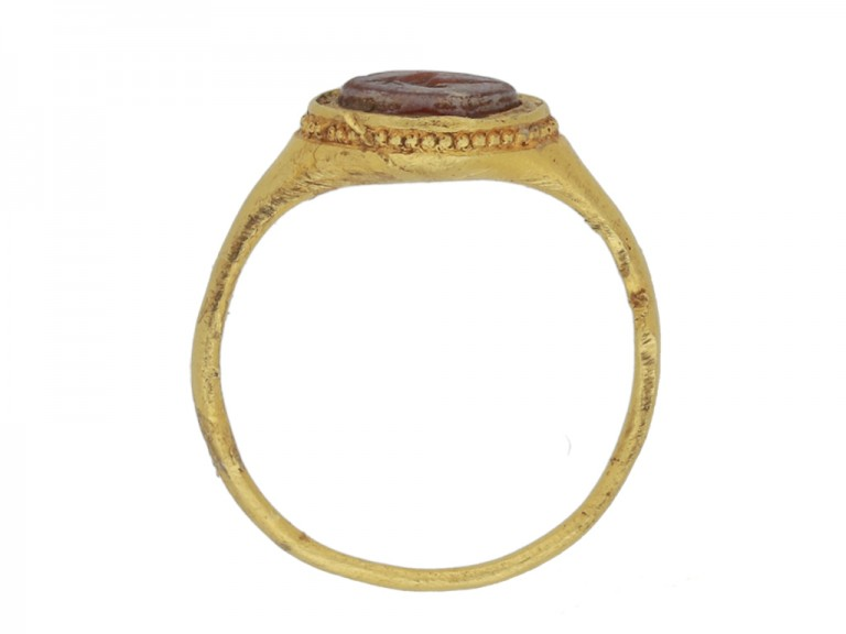 back view Ancient Roman gold ring with vine leaf intaglio, circa 3rd century AD.