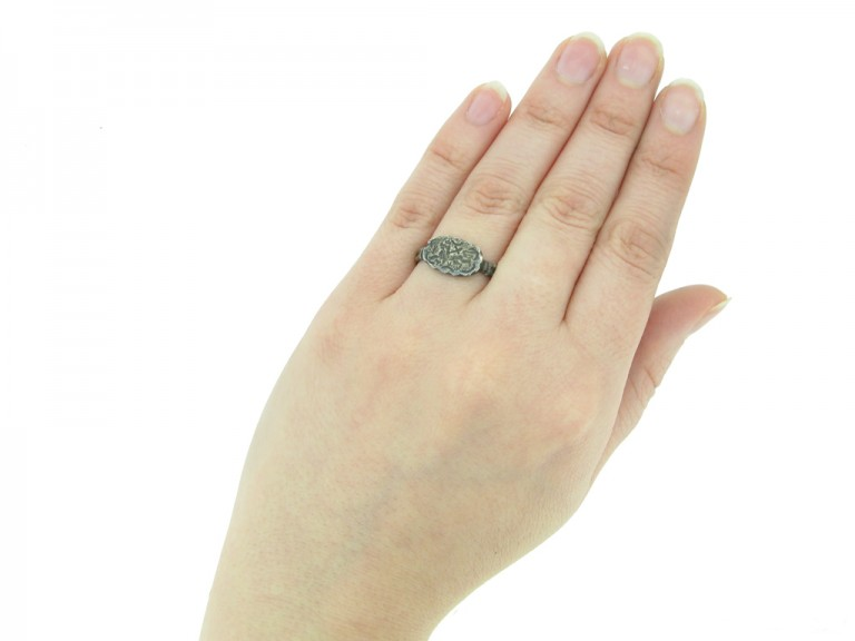 hand view Medieval silver ring with Agnus Dei, circa 15th century.